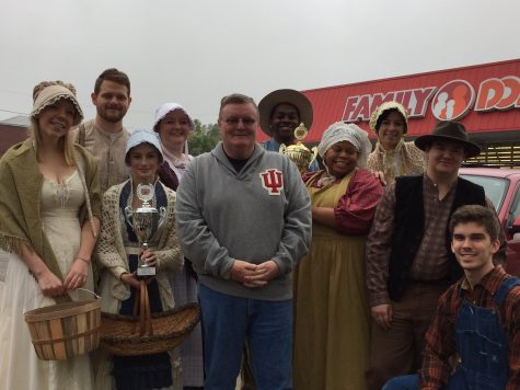 Chancellor Ray Wallace with members of the IU Southeast Theatre Department at the Harvest Homecoming Parade.
