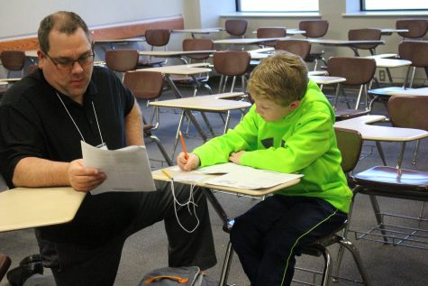 A student getting help with some math problems.