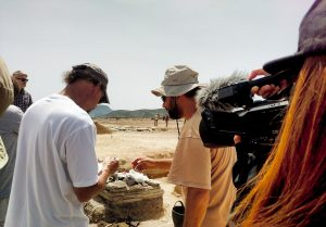 A student filming Albert William (left), research associate in the Media Arts and Sciences department at IUPUI and one of the coordinators for the IUPUI study abroad trip to Greece, working with one of the archaeologists at an active archaeological site on the island of Despotiko off the coast of Paros, Greece in the Cyclades.