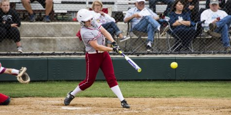 Emily Weiss, sophomore, takes a swing at an incoming pitch.