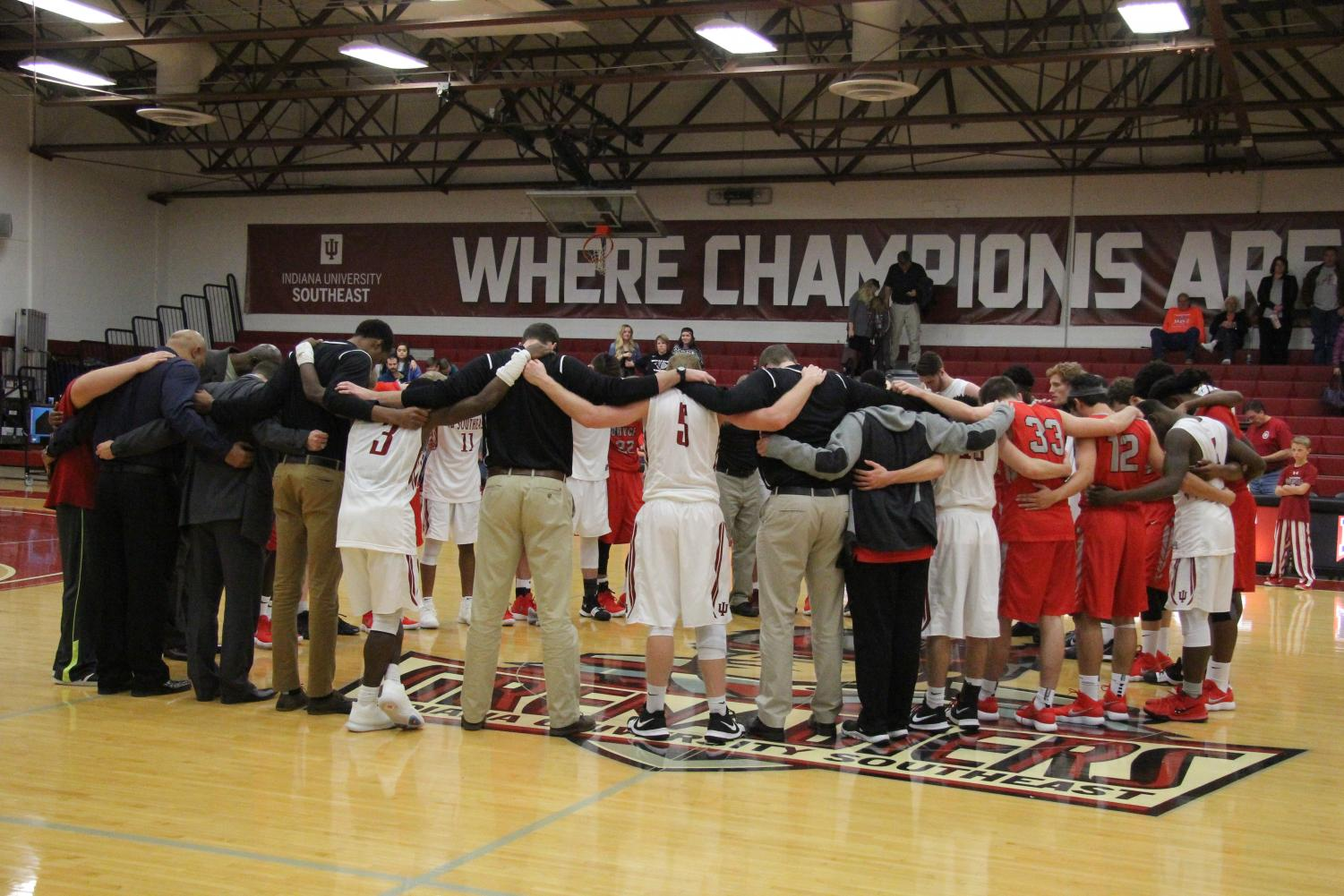 After+a+Grenadier+victory+against+Boyce+College%2C+both+men%E2%80%99s+basketball+teams+gathered+for+prayer.+Reed+Deoseu%2C+political+science+sophomore%2C+said+the+team+came+out+and+put+forth+the+effort+to+show+what+it+takes+to+win.
