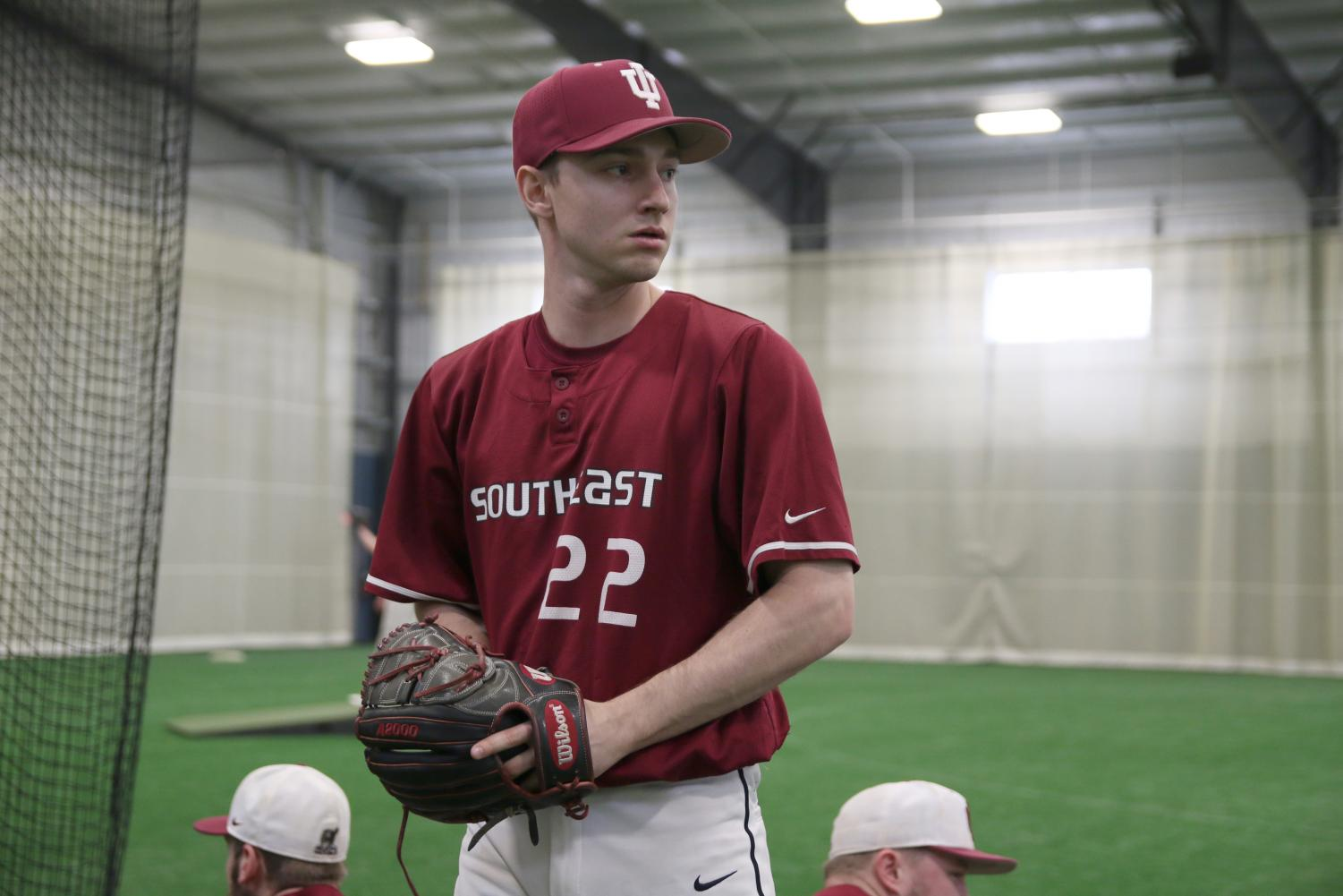 John Cecil, senior right-handed pitcher, warms up from the stretch at practice.