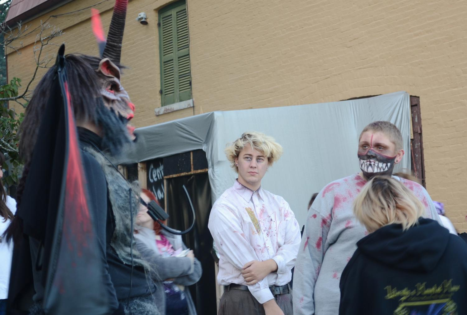 Holly Johnson, one of the directors of The Friends of the Culbertson Mansion and the creature featured left, gave some encouraging words to other hauntly, death looking actors for opening night Friday, Sept. 28.