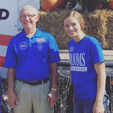 Kimberly Wrigley (right) worked at Ron Grooms' booth at this year's Harvest Homecoming parade. Wrigley's other responsibilities on the campaign include calling news stations to arrange interviews, delivering yard signs, going door-to-door to talk to voters and helping at other events and community festivals.