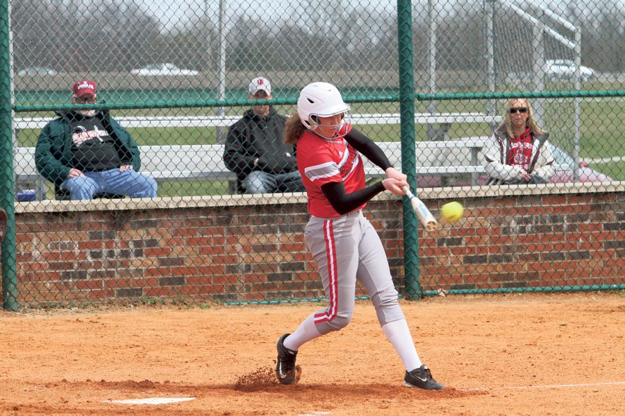 Senior+pitcher+Becca+Schoenung+hits+a+fastball+to+avoid+a+strike.+Photo+courtesy+of+IUS+Athletics%2C+used+with+permission.