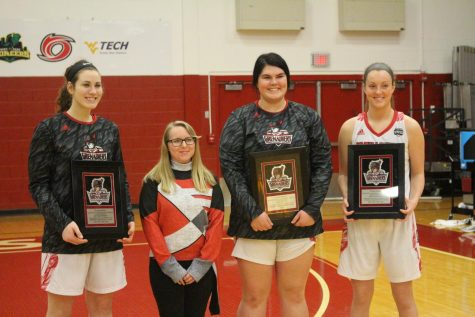 (From left to right) Baylee Kreuger, IUS Pep Band senior Kristina Peter, Kelsi Scott, and Josie Hockman pose for pictures prior to the Grenadiers