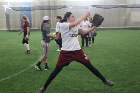 Pitcher Emily Weiss fires a pitch during an indoor practice at the Silver Street Park indoor facility in New Albany.