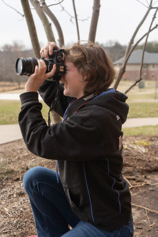 Junior Paris Brock looks through the viewfinder on her camera to line up a shot. During class, students are encouraged to experiment with their cameras.
