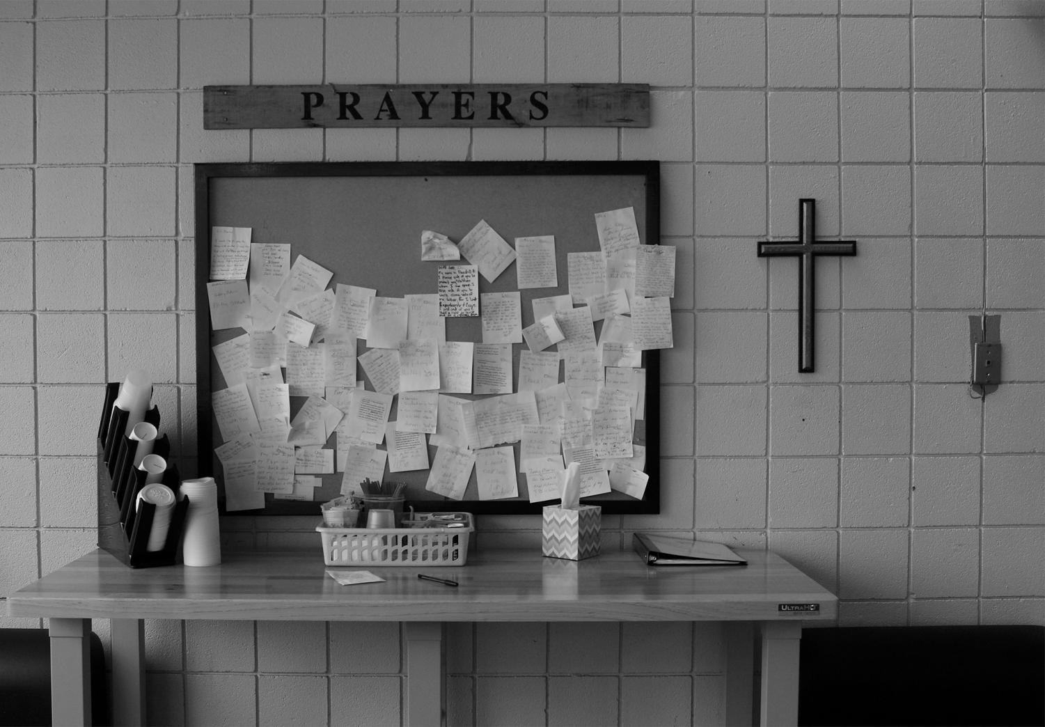 8th Street Pizza exists to build relationships with the community and the pizza is just secondary to that. This wall of prayers is part of the restaurant that shows the priority of helping people. Photo by Callie Manias.