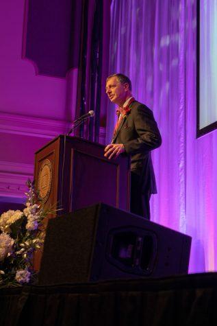 Jerry Finn gives a short speech after receiving his Chancellor's Medallion Award.