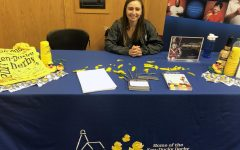 Robin Pitmann, communications and outreach coordinator for Harbor House of Louisville, sits at her organization's table at the annual IUS Volunteer Fair.