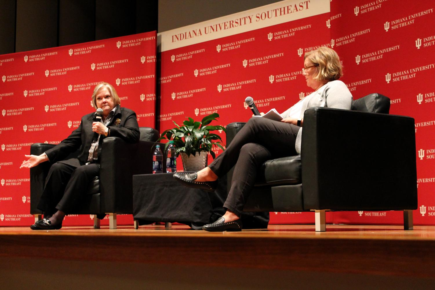 Judy Shepard (left) gestures as she answers a question from an audience member.