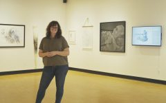 Emily Sheehan, assistant professor of fine arts, stands in the Barr Gallery.