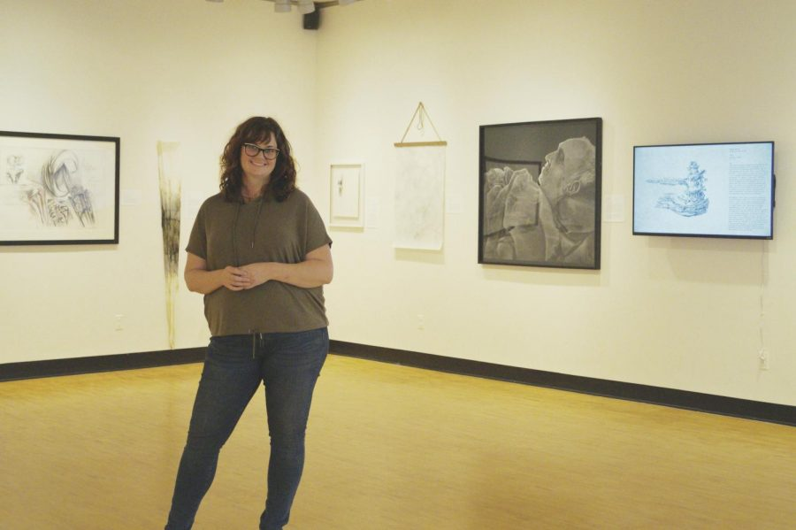 Emily+Sheehan%2C+assistant+professor+of+fine+arts%2C+stands+in+the+Barr+Gallery.