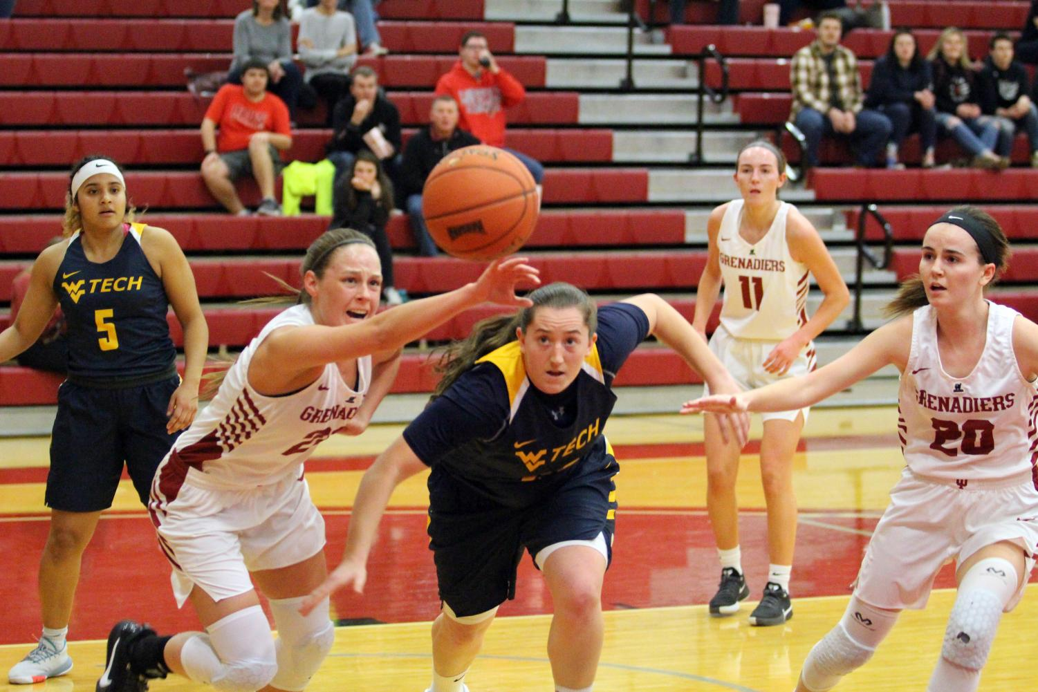 Ariana Sandefur (left) and WVU Tech's Logan Dudley rush after a loose ball in the third quarter.