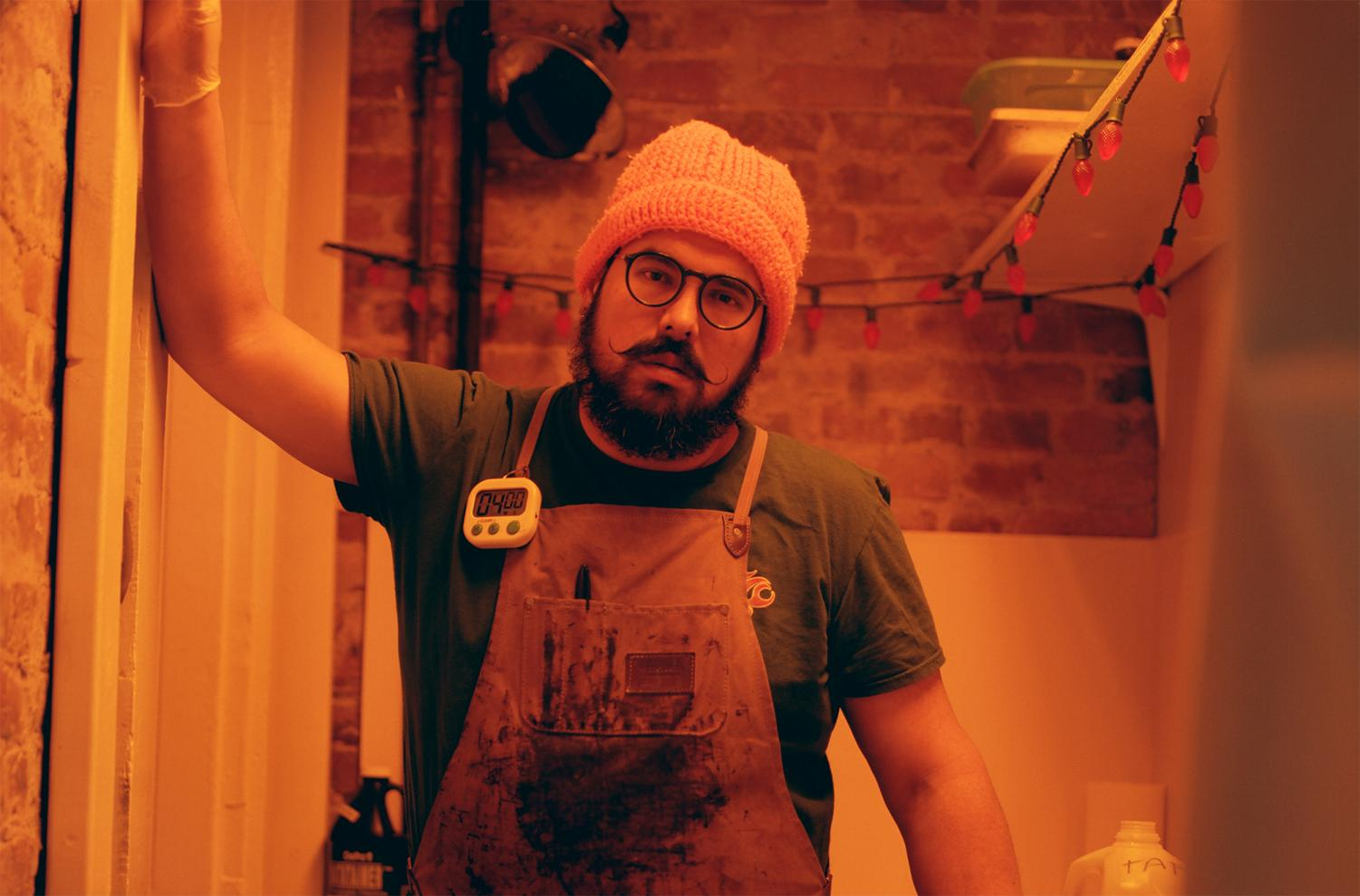 Rudy Salgado stands in his darkroom, a repurposed closet dimly lit with an orange safelight. In this small space, Salgado prepares and develops his tintype photos.