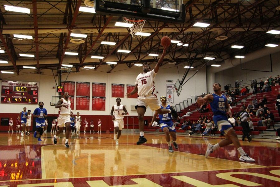 Junior+David+Burton+goes+up+for+a+fastbreak+layup+during+the+first+half+of+the+Grenadiers%E2%80%99+RSC+Quarterfinal+victory+over+Ohio+Christian.%0A