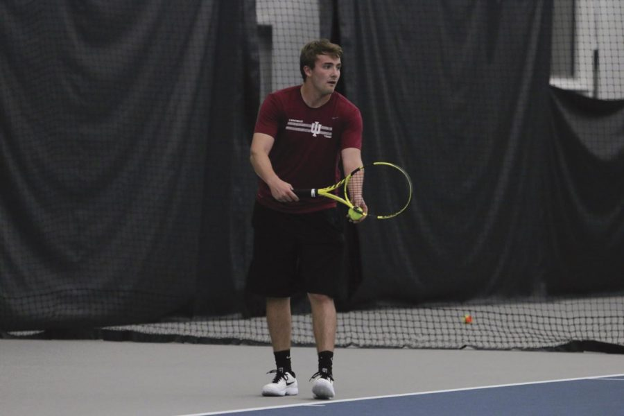 Brock+Winchell+prepares+to+serve+during+a+match+against+Asbury+University+on+April+11%2C+2019.