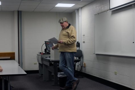"Roger Baylor reads an excerpt from a poem during his ""The History of Beer in New Albany"" presentation at IU Southeast."